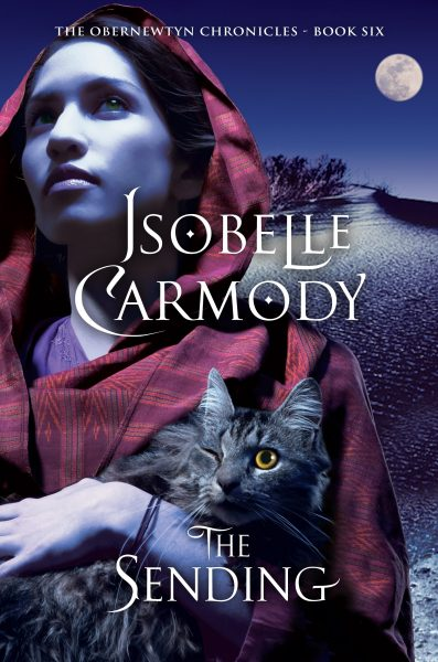 The Sending: a girl wearing a headscarf holds a cat