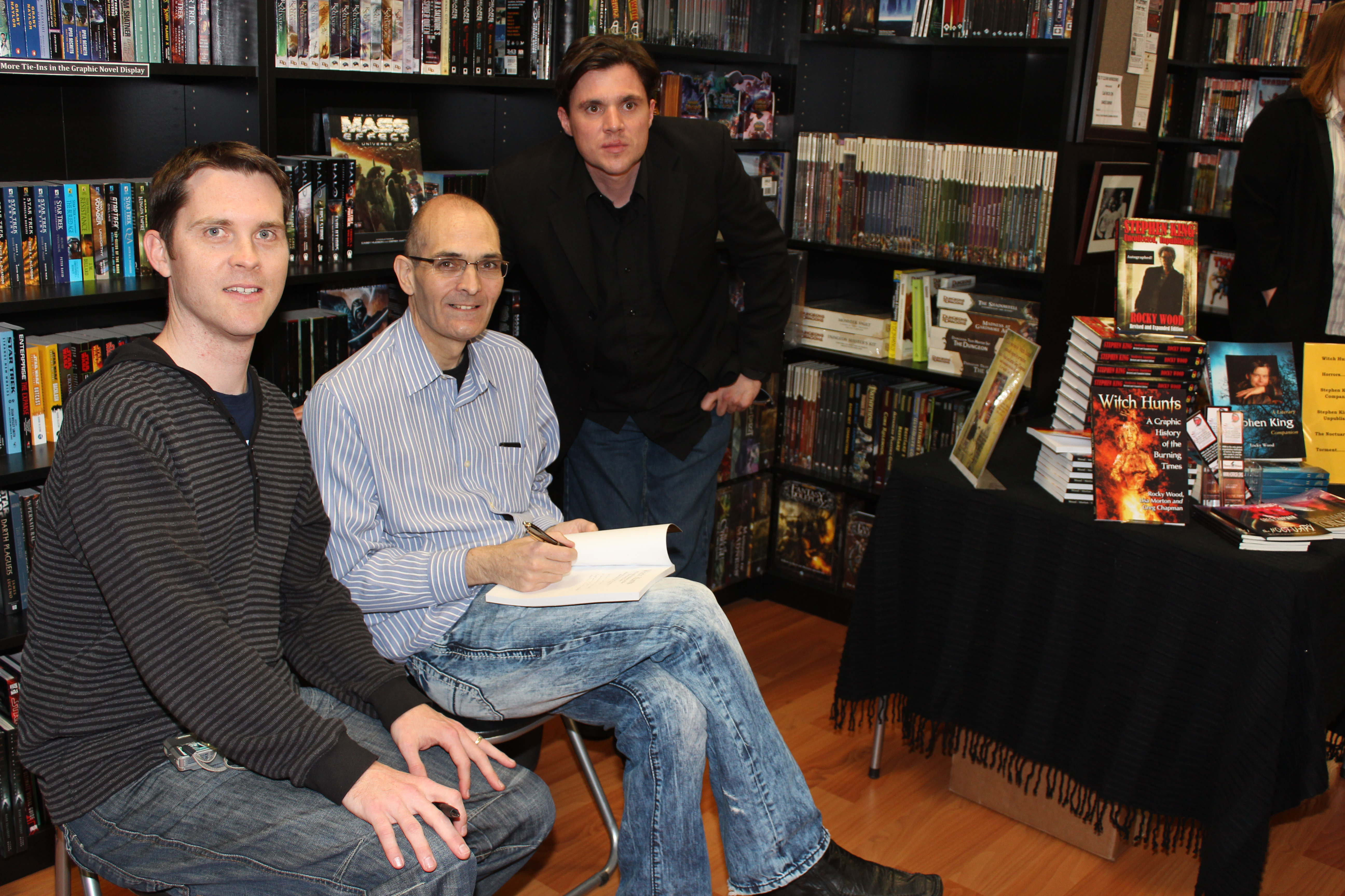Greg Chapman, Rocky Wood and friend with books at the launch