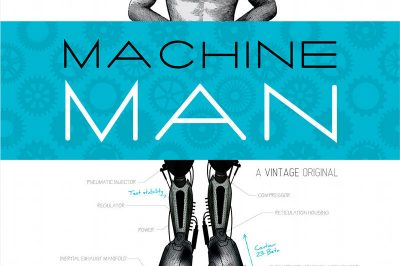 Machine Man - a man's torso and head appear above the title but robotic legs protrude below the title