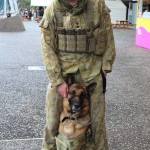 Real army dude outside with a dog - he was at the careers expo next door.