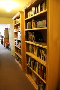 shelfie: This is both the bookshelves in the hall, with the one not previously pictured closer to the camera. I can't photograph this shelf straight on because HALL. And no door opposite.