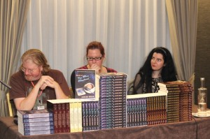 Russell B Farr, Liz Grzyb and Tali Helene behind a wall of books