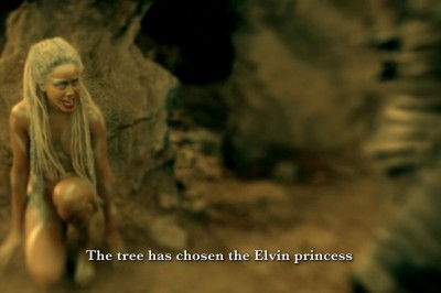 Changeling: the naked female changeling demon crouches on the ground while informing the Dagda Mor, her master, that the tree has chosen the Elven princess