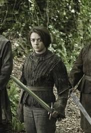 Dark Wings, Dark Words — Arya Stark stands between her friends with a sword raised