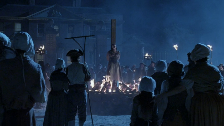 Sleepy Hollow Blood Moon — villagers and a man in a tricorn hat burn a woman at a stake