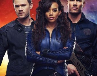 Killjoys — a man stands on either side of a woman