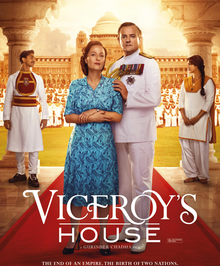 Viceroy's House: Lady and Lord Mountbatten stand in the centre on red carpet with an Indian man to the left and his love interest to the right
