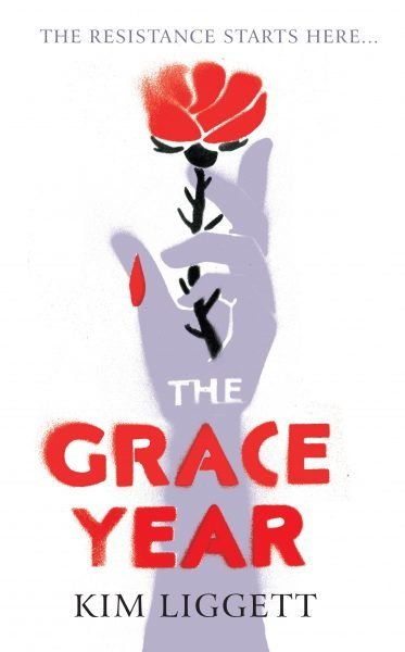 The Grace Year - a red rose sheds one petal; the rose is in a hand