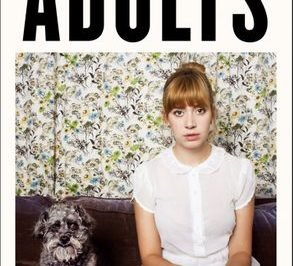 Adults - a woman sits on a couch next to a dog
