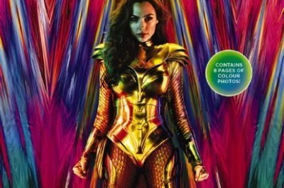 WW84: Wonder Woman wears a gold costume and stands in front of a rainbow-colored backdrop