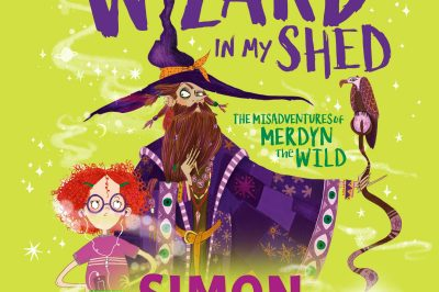 the Wizard in my Shed: a red-haired bespectacled girl stands beside a purple clad wizard