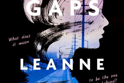 The Gaps: a silhouette of a teenage girl exposes a city scene
