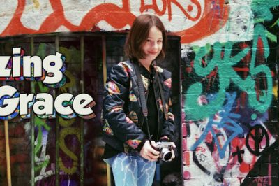 Amazing Grace: Grace stands in front of graffiti
