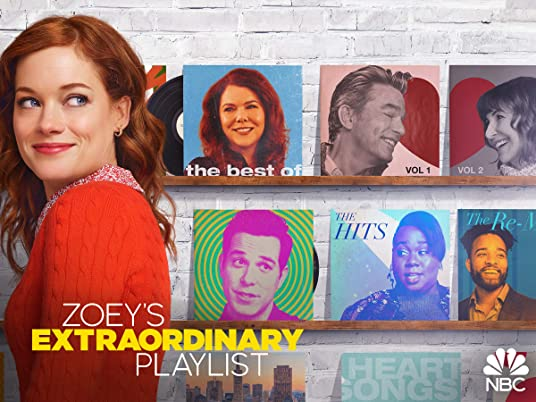 Zoey's extraordinary playlist : Zoey looks over her shoulder. Behind her are record album covers featuring other stars